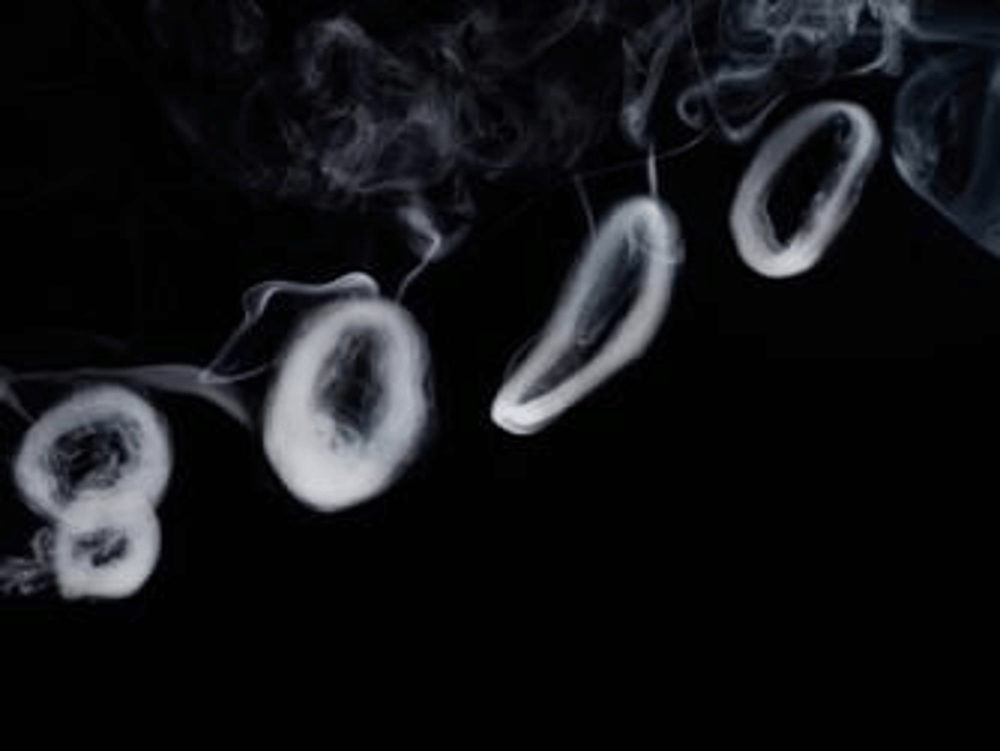 Blowing smoke rings